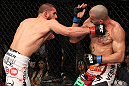 SYDNEY, AUSTRALIA - MARCH 03:  (L-R) Court McGee punches Constantinos Philippou in a middleweight bout during the UFC on FX event at Allphones Arena on March 3, 2012 in Sydney, Australia.  (Photo by Josh Hedges/Zuffa LLC/Zuffa LLC via Getty Images) *** Local Caption *** Court McGee; Constantinos Philippou