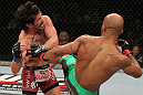 SYDNEY, AUSTRALIA - MARCH 03:  (R-L) Demetrious Johnson kicks Ian McCall in a flyweight bout during the UFC on FX event at Allphones Arena on March 3, 2012 in Sydney, Australia.  (Photo by Josh Hedges/Zuffa LLC/Zuffa LLC via Getty Images) *** Local Caption *** Demetrious Johnson; Ian McCall