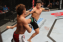 SYDNEY, AUSTRALIA - MARCH 03:  (R-L) Joseph Benavidez kicks Yasuhiro Urushitani in a flyweight bout during the UFC on FX event at Allphones Arena on March 3, 2012 in Sydney, Australia.  (Photo by Josh Hedges/Zuffa LLC/Zuffa LLC via Getty Images) *** Local Caption *** Joseph Benavidez; Yasuhiro Urushitani