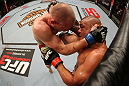 SYDNEY, AUSTRALIA - MARCH 03:  (L-R) Martin Kampmann delivers a knee strike against Thiago Alves in a welterweight bout during the UFC on FX event at Allphones Arena on March 3, 2012 in Sydney, Australia.  (Photo by Josh Hedges/Zuffa LLC/Zuffa LLC via Getty Images) *** Local Caption *** Thiago Alves; Martin Kampmann