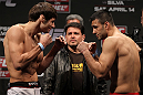 STOCKHOLM, SWEDEN - APRIL 13:  (L-R) Welterweight opponents Simeon Thoresen and Besam Yousef face off after weighing in during the official UFC on Fuel TV weigh in event at Ericsson Globe on April 13, 2012 in Stockholm, Sweden.  (Photo by Josh Hedges/Zuffa LLC/Zuffa LLC via Getty Images)