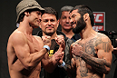STOCKHOLM, SWEDEN - APRIL 13:  (L-R) Bantamweight opponents Brad Pickett and Damacio Page face off after weighing in during the official UFC on Fuel TV weigh in event at Ericsson Globe on April 13, 2012 in Stockholm, Sweden.  (Photo by Josh Hedges/Zuffa LLC/Zuffa LLC via Getty Images)