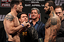 STOCKHOLM, SWEDEN - APRIL 13:  (L-R) Middleweight opponents Brian Stann and Alessio Sakara face off after weighing in during the official UFC on Fuel TV weigh in event at Ericsson Globe on April 13, 2012 in Stockholm, Sweden.  (Photo by Josh Hedges/Zuffa LLC/Zuffa LLC via Getty Images)
