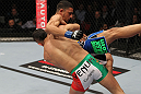 STOCKHOLM, SWEDEN - APRIL 14:  (L-R) Reza Madadi slams Yoislandy Izquierdo to the mat during their lightweight bout at the UFC on Fuel TV event at Ericsson Globe on April 14, 2012 in Stockholm, Sweden.  (Photo by Josh Hedges/Zuffa LLC/Zuffa LLC via Getty Images)