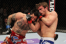 STOCKHOLM, SWEDEN - APRIL 14:  (R-L) Brad Pickett punches Damacio Page during their bantamweight bout at the UFC on Fuel TV event at Ericsson Globe on April 14, 2012 in Stockholm, Sweden.  (Photo by Josh Hedges/Zuffa LLC/Zuffa LLC via Getty Images)