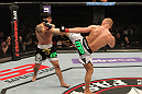 STOCKHOLM, SWEDEN - APRIL 14:  (R-L) Dennis Siver kicks Diego Nunes during their featherweight bout at the UFC on Fuel TV event at Ericsson Globe on April 14, 2012 in Stockholm, Sweden.  (Photo by Josh Hedges/Zuffa LLC/Zuffa LLC via Getty Images)