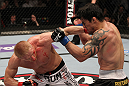 STOCKHOLM, SWEDEN - APRIL 14:  (L-R) Dennis Siver punches Diego Nunes during their featherweight bout at the UFC on Fuel TV event at Ericsson Globe on April 14, 2012 in Stockholm, Sweden.  (Photo by Josh Hedges/Zuffa LLC/Zuffa LLC via Getty Images)