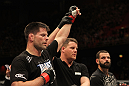 STOCKHOLM, SWEDEN - APRIL 14:  Brian Stann (L) reacts after defeating Alessio Sakara (R) by TKO in a middleweight bout at the UFC on Fuel TV event at Ericsson Globe on April 14, 2012 in Stockholm, Sweden.  (Photo by Josh Hedges/Zuffa LLC/Zuffa LLC via Getty Images)