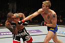 STOCKHOLM, SWEDEN - APRIL 14:  (R-L) Alexander Gustafsson punches Thiago Silva during their light heavyweight bout at the UFC on Fuel TV event at Ericsson Globe on April 14, 2012 in Stockholm, Sweden.  (Photo by Josh Hedges/Zuffa LLC/Zuffa LLC via Getty Images)