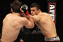 STOCKHOLM, SWEDEN - APRIL 14:  (R-L) Besam Yousef punches Simeon Thoresen during their welterweight bout at the UFC on Fuel TV event at Ericsson Globe on April 14, 2012 in Stockholm, Sweden.  (Photo by Josh Hedges/Zuffa LLC/Zuffa LLC via Getty Images)