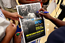 ATLANTA, GA - APRIL 19:  Rashad Evans signs autographs after working out for the media during UFC 145 open workouts at GSU Sports Arena on April 19, 2012 in Atlanta, Georgia.  (Photo by Kevin C. Cox/Zuffa LLC/Zuffa LLC via Getty Images)