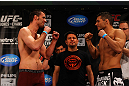 ATLANTA, GA - APRIL 20:  Welterweight fighters Keith Wisniewski (L) and Chris Clements square off during the UFC 145 official weigh in at Fox Theatre on April 20, 2012 in Atlanta, Georgia.  (Photo by Al Bello/Zuffa LLC/Zuffa LLC via Getty Images)