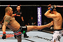 ATLANTA, GA - APRIL 21:  Travis Browne (L) kicks Chad Griggs during their heavyweight bout for UFC 145 at Philips Arena on April 21, 2012 in Atlanta, Georgia.  (Photo by Al Bello/Zuffa LLC/Zuffa LLC via Getty Images)