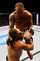 ATLANTA, GA - APRIL 21:  Travis Browne (back) lands a knee on Chad Griggs during their heavyweight bout for UFC 145 at Philips Arena on April 21, 2012 in Atlanta, Georgia.  (Photo by Al Bello/Zuffa LLC/Zuffa LLC via Getty Images)