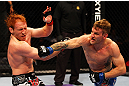 ATLANTA, GA - APRIL 21:  John Alessio (R) punches Mark Bocek during their lightweight bout for UFC 145 at Philips Arena on April 21, 2012 in Atlanta, Georgia.  (Photo by Al Bello/Zuffa LLC/Zuffa LLC via Getty Images)