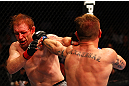 ATLANTA, GA - APRIL 21:  John Alessio (R) hits Mark Bocek during their lightweight bout for UFC 145 at Philips Arena on April 21, 2012 in Atlanta, Georgia.  (Photo by Al Bello/Zuffa LLC/Zuffa LLC via Getty Images)