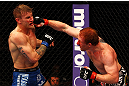 ATLANTA, GA - APRIL 21:  Mark Bocek (R) punches John Alessio during their lightweight bout for UFC 145 at Philips Arena on April 21, 2012 in Atlanta, Georgia.  (Photo by Al Bello/Zuffa LLC/Zuffa LLC via Getty Images)