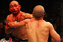 ATLANTA, GA - APRIL 21:  Eddie Yagin (L) punches Mark Hominick during their featherweight bout for UFC 145 at Philips Arena on April 21, 2012 in Atlanta, Georgia.  (Photo by Al Bello/Zuffa LLC/Zuffa LLC via Getty Images)