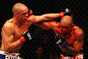 ATLANTA, GA - APRIL 21:  Eddie Yagin (R) punches Mark Hominick during their featherweight bout for UFC 145 at Philips Arena on April 21, 2012 in Atlanta, Georgia.  (Photo by Al Bello/Zuffa LLC/Zuffa LLC via Getty Images)
