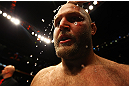 ATLANTA, GA - APRIL 21:  Water is applied to Ben Rothwell's head after he defeated Brendan Schaub by TKO in the first round of their heavyweight bout for UFC 145 at Philips Arena on April 21, 2012 in Atlanta, Georgia.  (Photo by Al Bello/Zuffa LLC/Zuffa LLC via Getty Images)