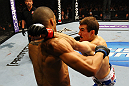 ATLANTA, GA - APRIL 21:  Rory MacDonald (R) punches Che Mills during their welterweight bout for UFC 145 at Philips Arena on April 21, 2012 in Atlanta, Georgia.  (Photo by Al Bello/Zuffa LLC/Zuffa LLC via Getty Images)