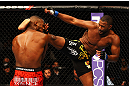 ATLANTA, GA - APRIL 21:  Rashad Evans (R) kicks Jon Jones during their light heavyweight title bout for UFC 145 at Philips Arena on April 21, 2012 in Atlanta, Georgia.  (Photo by Al Bello/Zuffa LLC/Zuffa LLC via Getty Images)