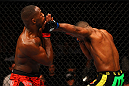 ATLANTA, GA - APRIL 21:  Rashad Evans (R) hits Jon Jones during their light heavyweight title bout for UFC 145 at Philips Arena on April 21, 2012 in Atlanta, Georgia.  (Photo by Al Bello/Zuffa LLC/Zuffa LLC via Getty Images)