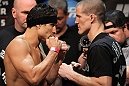 EAST RUTHERFORD, NJ - MAY 04:  (L-R) Lightweight opponents Danny Castillo and John Cholish face off after weighing in during the UFC on FOX official weigh in at Izod Center on May 4, 2012 in East Rutherford, New Jersey.  (Photo by Josh Hedges/Zuffa LLC/Zuffa LLC via Getty Images)