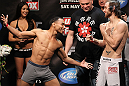EAST RUTHERFORD, NJ - MAY 04:  (L-R) Flyweight opponents John Dodson and Timothy Elliot face off after weighing in during the UFC on FOX official weigh in at Izod Center on May 4, 2012 in East Rutherford, New Jersey.  (Photo by Josh Hedges/Zuffa LLC/Zuffa LLC via Getty Images)