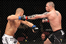 EAST RUTHERFORD, NJ - MAY 05:  Karlos Vemola (L) and Mike Massenzio (R) fight during thier Middleweight bout at Izod Center on May 5, 2012 in East Rutherford, New Jersey.  (Photo by Josh Hedges/Zuffa LLC/Zuffa LLC via Getty Images)
