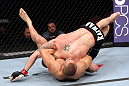 EAST RUTHERFORD, NJ - MAY 05:  Mike Massenzio slams Karlos Vemola during thier Middleweight bout at Izod Center on May 5, 2012 in East Rutherford, New Jersey.  (Photo by Josh Hedges/Zuffa LLC/Zuffa LLC via Getty Images)
