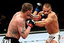 EAST RUTHERFORD, NJ - MAY 05:   Mike Massenzio punches Karlos Vemola during thier Middleweight bout at Izod Center on May 5, 2012 in East Rutherford, New Jersey.  (Photo by Josh Hedges/Zuffa LLC/Zuffa LLC via Getty Images)