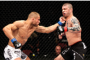 EAST RUTHERFORD, NJ - MAY 05:  Karlos Vemola punches Mike Massenzio during thier Middleweight bout at Izod Center on May 5, 2012 in East Rutherford, New Jersey.  (Photo by Josh Hedges/Zuffa LLC/Zuffa LLC via Getty Images)