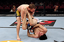 EAST RUTHERFORD, NJ - MAY 05:  Nick Denis slams Roland Delorme to the ground during thier Bantamweight bout at Izod Center on May 5, 2012 in East Rutherford, New Jersey.  (Photo by Josh Hedges/Zuffa LLC/Zuffa LLC via Getty Images)