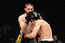 EAST RUTHERFORD, NJ - MAY 05:  Nick Denis punches Roland Delorme during thier Bantamweight bout at Izod Center on May 5, 2012 in East Rutherford, New Jersey.  (Photo by Josh Hedges/Zuffa LLC/Zuffa LLC via Getty Images)