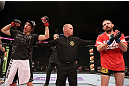 EAST RUTHERFORD, NJ - MAY 05:  Roland Delorme (L) celebrates after defeating Nick Denis in thier Bantamweight bout at Izod Center on May 5, 2012 in East Rutherford, New Jersey.  (Photo by Josh Hedges/Zuffa LLC/Zuffa LLC via Getty Images)