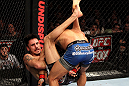 EAST RUTHERFORD, NJ - MAY 05:  Dennis Bermudez slams Pablo Garza to the ground during thier Bantamweight bout at Izod Center on May 5, 2012 in East Rutherford, New Jersey.  (Photo by Josh Hedges/Zuffa LLC/Zuffa LLC via Getty Images)