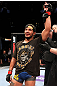 EAST RUTHERFORD, NJ - MAY 05:  Dennis Bermudez celebrates after defeating Pablo Garza in thier Bantamweight bout at Izod Center on May 5, 2012 in East Rutherford, New Jersey.  (Photo by Josh Hedges/Zuffa LLC/Zuffa LLC via Getty Images)