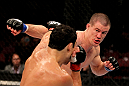 EAST RUTHERFORD, NJ - MAY 05: John Cholish (R) punches Danny Castillo during thier Lightweight bout at Izod Center on May 5, 2012 in East Rutherford, New Jersey.  (Photo by Josh Hedges/Zuffa LLC/Zuffa LLC via Getty Images)