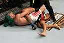 EAST RUTHERFORD, NJ - MAY 05:  Louis Gaudinot chokes out John Lineker to defeat him in thier Flyweight bout at Izod Center on May 5, 2012 in East Rutherford, New Jersey.  (Photo by Josh Hedges/Zuffa LLC/Zuffa LLC via Getty Images)