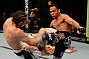 EAST RUTHERFORD, NJ - MAY 05:  John Dodson (R) and Timothy Elliott (L) fight during thier Flyweight bout at Izod Center on May 5, 2012 in East Rutherford, New Jersey.  (Photo by Josh Hedges/Zuffa LLC/Zuffa LLC via Getty Images)