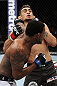 EAST RUTHERFORD, NJ - MAY 05:  Michael Johnson punches Tony Ferguson during thier Flyweight bout at Izod Center on May 5, 2012 in East Rutherford, New Jersey.  (Photo by Josh Hedges/Zuffa LLC/Zuffa LLC via Getty Images)