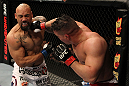 EAST RUTHERFORD, NJ - MAY 05: Pat Barry (R) punches Lavar Johnson (L) during thier Heavyweight bout at Izod Center on May 5, 2012 in East Rutherford, New Jersey.  (Photo by Josh Hedges/Zuffa LLC/Zuffa LLC via Getty Images)
