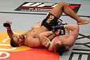 EAST RUTHERFORD, NJ - MAY 05:  Alan Belcher (R) wrestles Rousimar Palhares (L) to the ground during thier Middleweight bout at Izod Center on May 5, 2012 in East Rutherford, New Jersey.  (Photo by Josh Hedges/Zuffa LLC/Zuffa LLC via Getty Images)