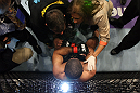EAST RUTHERFORD, NJ - MAY 05:  Rousimar Palhares gets looked over by his team after being defeated by Alan Belcher in thier Middleweight bout at Izod Center on May 5, 2012 in East Rutherford, New Jersey.  (Photo by Josh Hedges/Zuffa LLC/Zuffa LLC via Getty Images)