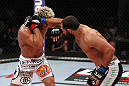 EAST RUTHERFORD, NJ - MAY 05:  Johny Hendricks (R) punches Josh Koscheck (L) during thier Welterweight bout at Izod Center on May 5, 2012 in East Rutherford, New Jersey.  (Photo by Josh Hedges/Zuffa LLC/Zuffa LLC via Getty Images)