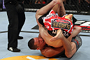 EAST RUTHERFORD, NJ - MAY 05:  Nate Diaz Takes down Jim Miller during thier Lightweight bout at Izod Center on May 5, 2012 in East Rutherford, New Jersey.  (Photo by Josh Hedges/Zuffa LLC/Zuffa LLC via Getty Images)