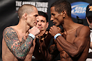 FAIRFAX, VA - MAY 14:  (L-R) Bantamweight opponents Jeff Curran and Johnny Eduardo face off after weighing in during the UFC on Fuel TV official weigh in at Patriot Center on May 14, 2012 in Fairfax, Virginia.  (Photo by Josh Hedges/Zuffa LLC/Zuffa LLC via Getty Images)