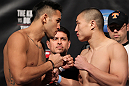 FAIRFAX, VA - MAY 14:  (L-R) Opponents Brad Tavares and Dongi Yang face off after weighing in during the UFC on Fuel TV official weigh in at Patriot Center on May 14, 2012 in Fairfax, Virginia.  (Photo by Josh Hedges/Zuffa LLC/Zuffa LLC via Getty Images)