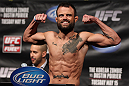 FAIRFAX, VA - MAY 14:  Jeff Hougland makes weight during the UFC on Fuel TV official weigh in at Patriot Center on May 14, 2012 in Fairfax, Virginia.  (Photo by Josh Hedges/Zuffa LLC/Zuffa LLC via Getty Images)